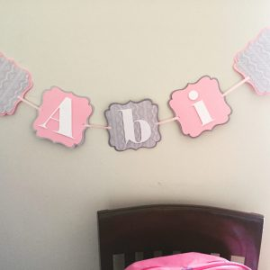 pink and light gray banner