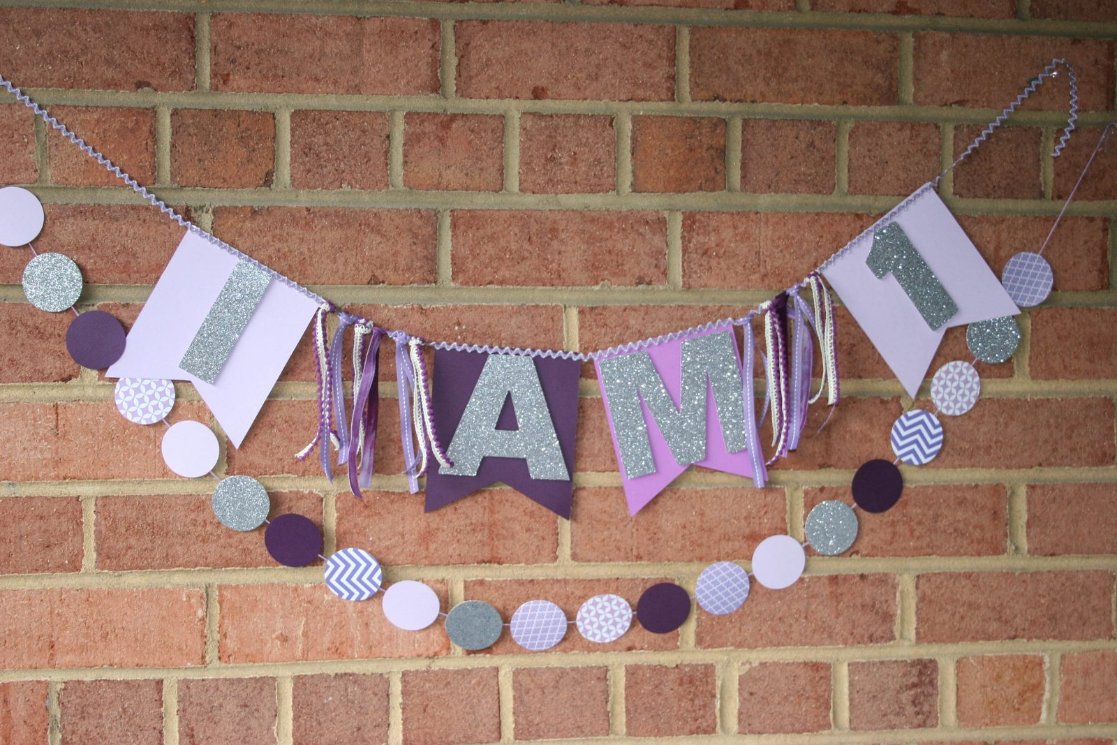 purple and silver high chair banner with garland
